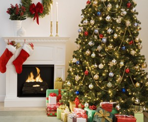 bedroom-comfortable-tree-decoration-with-colorful-ornament-ball-feat-many-christmas-gifts-near-santa-claus-socks-mounted-on-fireplace-also-chandelier-meets-white-flower-vase-and-green-wreath-on-mantel